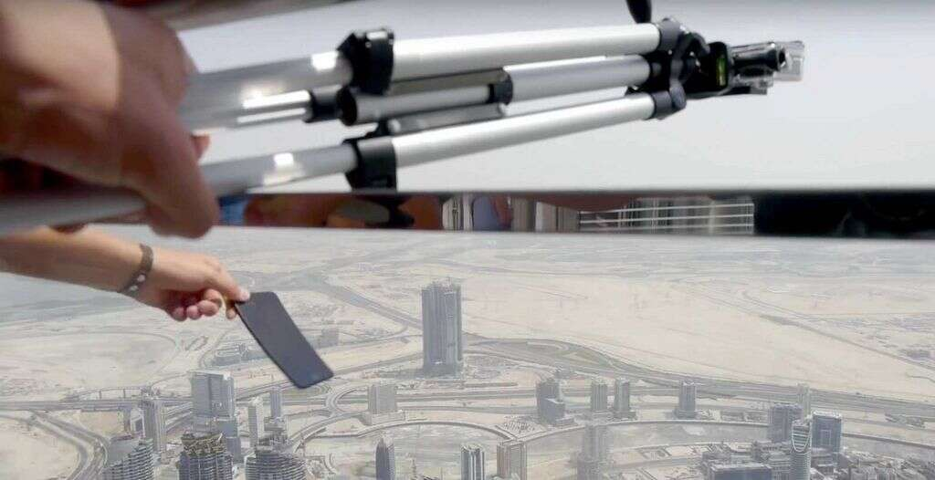 A screengrab from the video shot by a Ukrainian in which he drops a brand new iPhone from the 148th floor of Burj Khalifa. Police have made him sign an undertaking that he would never do such a thing again.