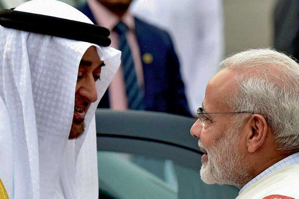 Sheikh Mohamed sharing a light moment with Narendra Modi during his reception at Delhi airport on Tuesday.