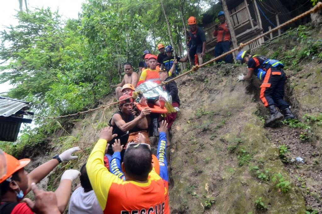 Massive landslide kills 21 and buries houses in Philippines