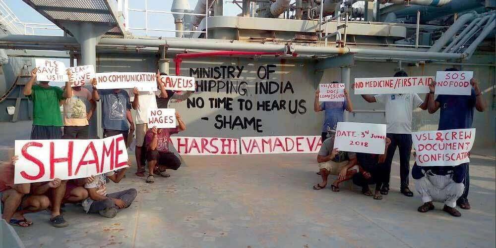 Seamen with placards carrying messages seeking action.- Supplied photo