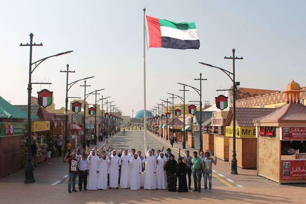 Global Village raises UAE flag in honour of National Flag Day