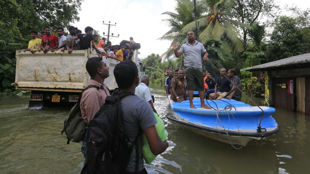 Cyclone aims for Bangladesh as flood toll rises to 164 in Sri Lanka