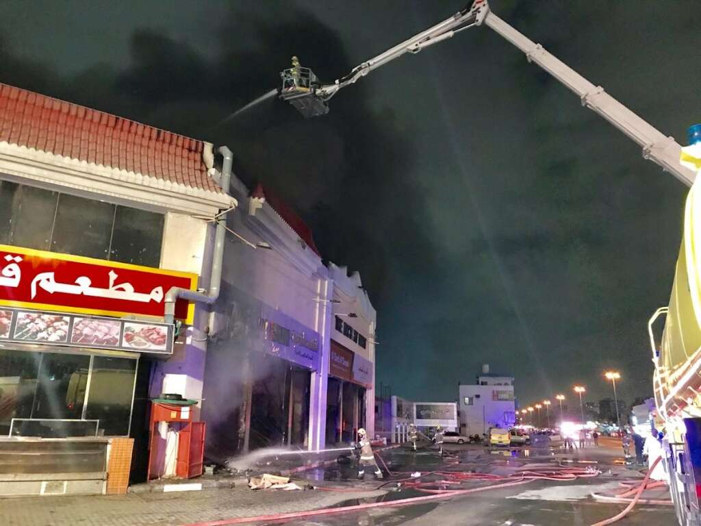 Fire fighters from four emirates put out massive fire in