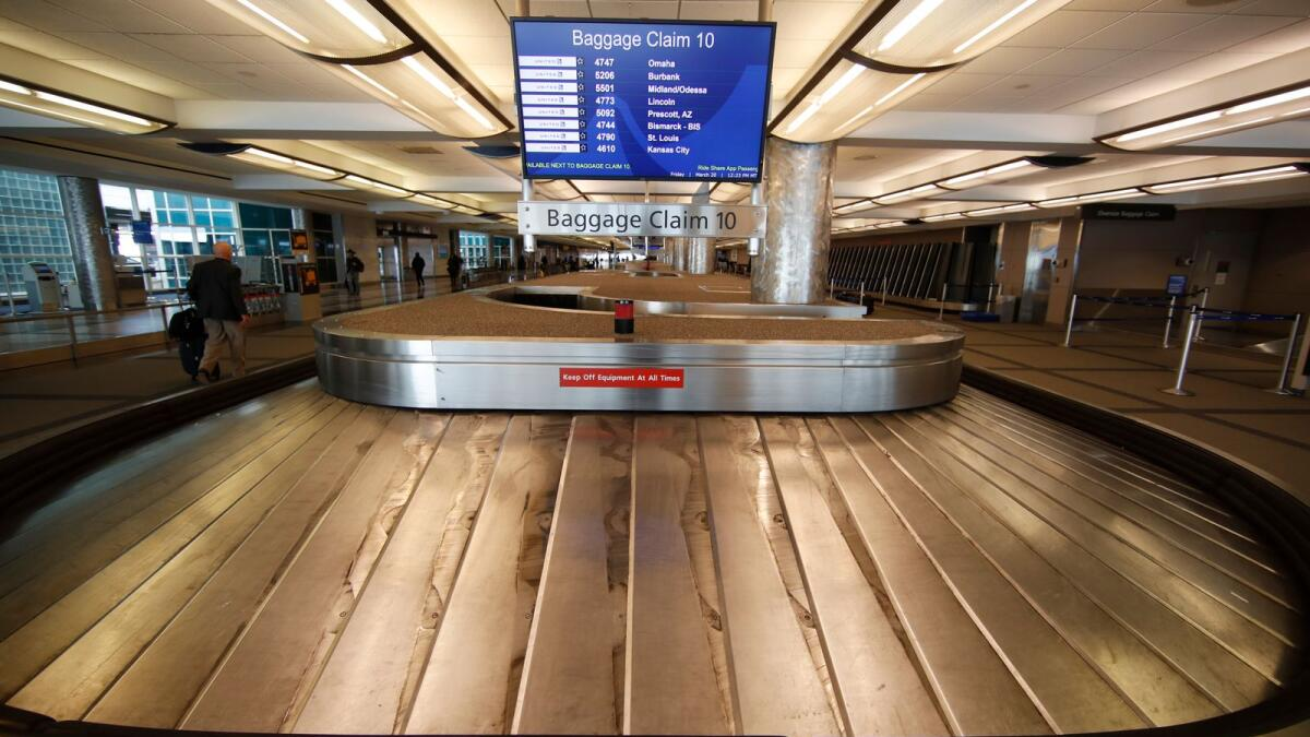 An empty bagage carousel spins in Denver International Airport. The International Air Transport Association  said net industry losses are expected to reduce to $11.6 billion in 2022 after a $51.8 billion loss in 2021, reflecting an increase of 8.6 per cent from $47.7 billion loss estimated in April. — AP file photo