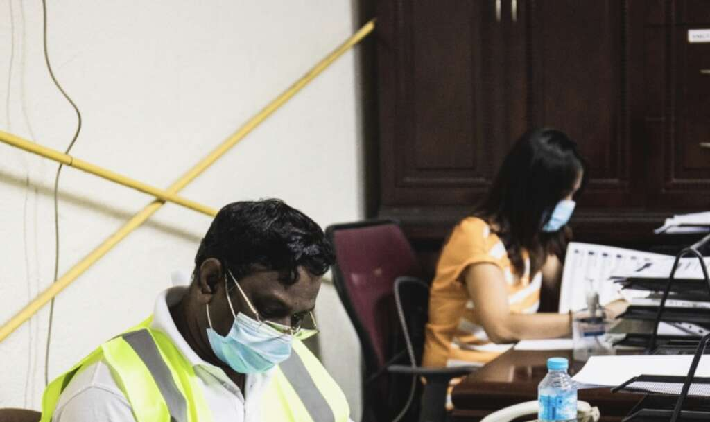 Combating, covid19, coronavirus, Dubai office-goers, back to work, masks, gloves on