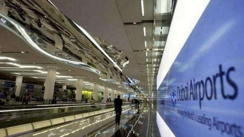 dubai airport, delays, heavy rain, cancellations, diversions