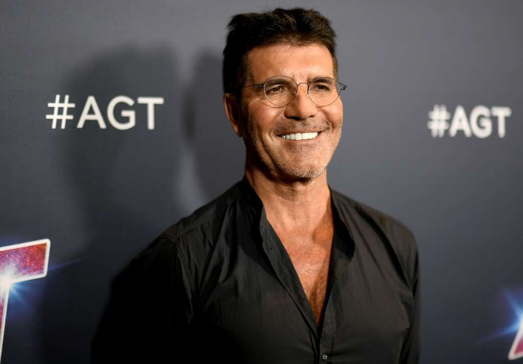 Simon cowell, injury, hospital, America got talent, one direction, music, hollywood