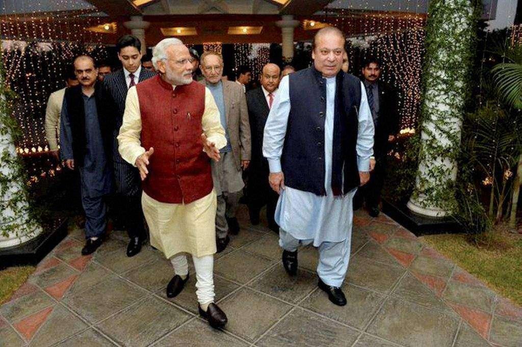 Modi touches Pakistani PM mothers feet as mark of respect