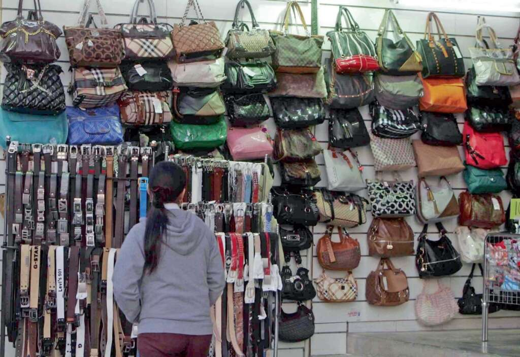 In Spite Of The Law Banning Fake Goods Replica Designer Bags Sungl Belts Wallets Shoeore Have A Thriving Market Country
