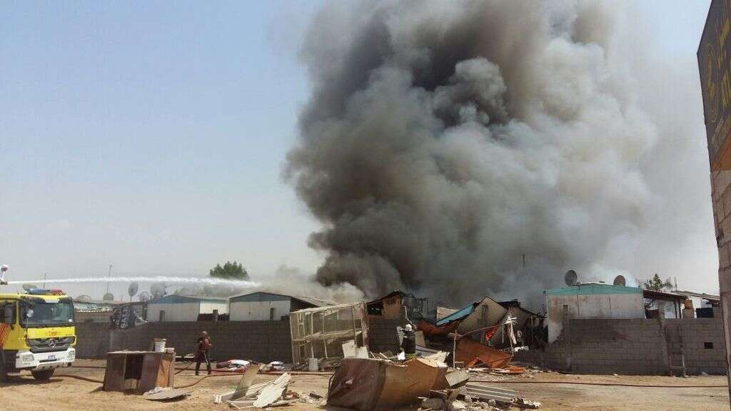 100 workers escape death after massive fire in labour camp