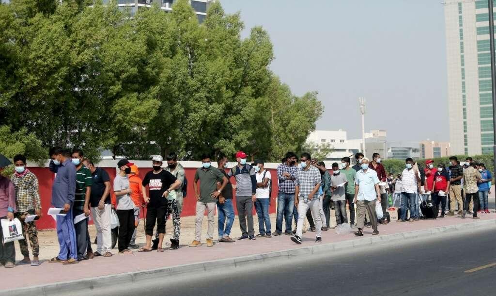 Long queues, rapid, Covid-19 test centre, Dubai, Al Ahli football club,
