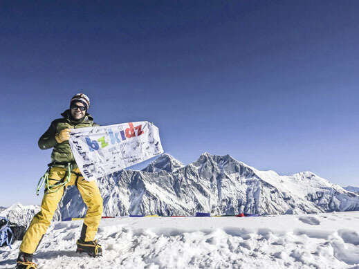 FOR A CAUSE: Rami Rasamny at the summit of one of his many personal expeditions