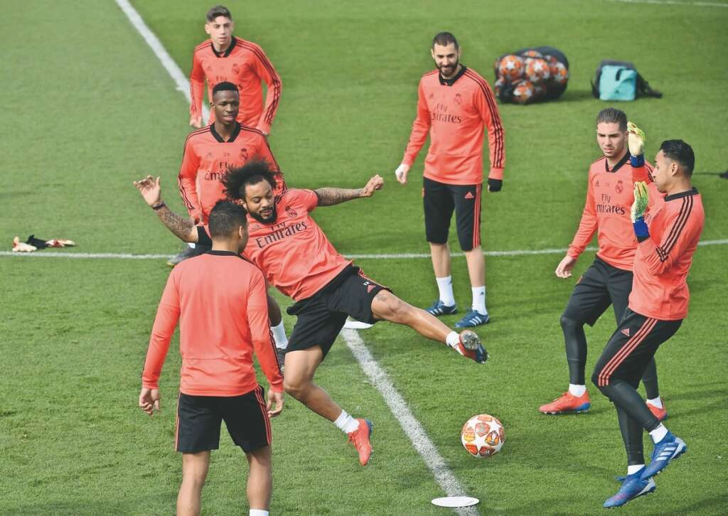 Real Madrid s Marcelo (centre) and goalkeeper Keylor Navas (right) attend a training  session with teammates on the eve of the UEFA Champions League d127f4269ca03