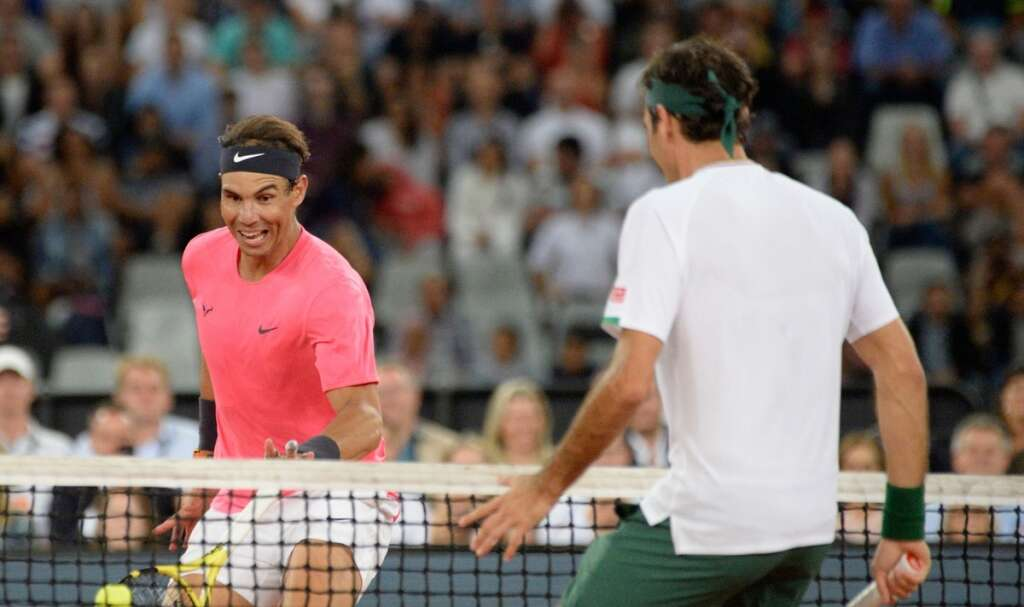 Federer, Nadal play draw record crowd in charity match