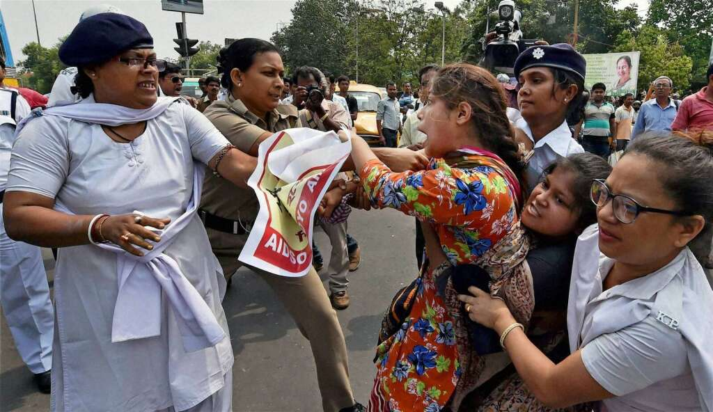 Police detain activists during a protest against the gang rape of a woman in Kolkata on Tuesday.