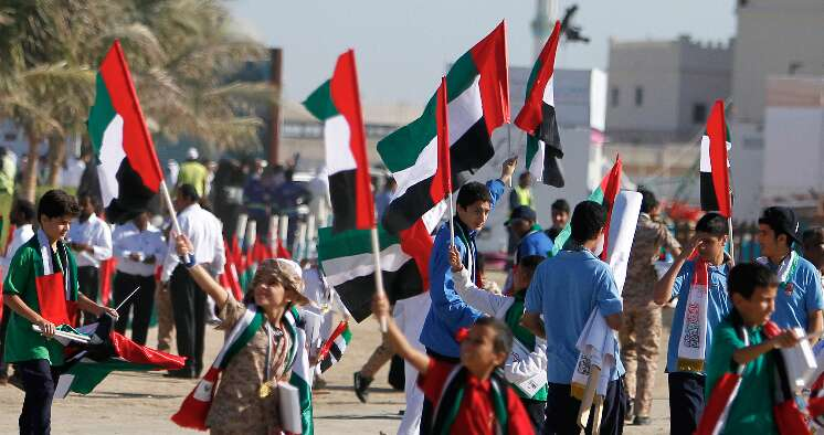 c0b21d00f2e40 Kids holding UAE flag during the 46th UAE National Day carnival organized  by Ajman police at Ajman Corniche on Wednesday is a part of 46th UAE  National Day ...