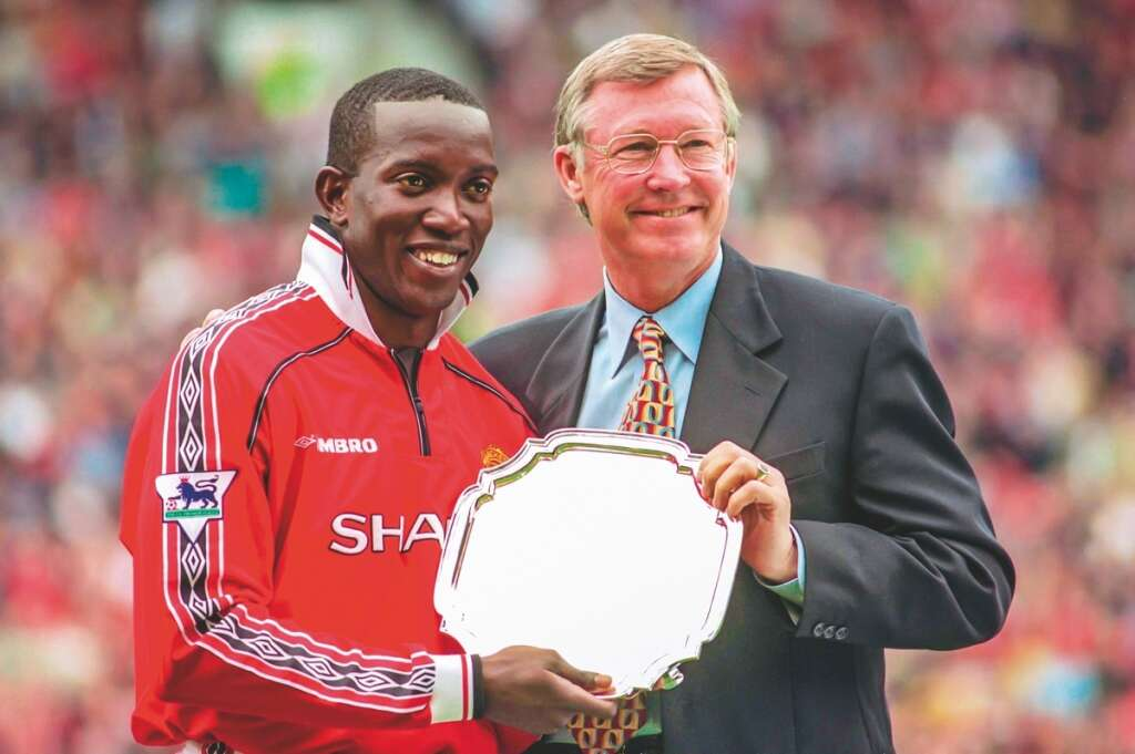 d33aea115 Manchester United manager Alex Ferguson (right) presents Dwight Yorke with  the club s Player of the Year award. Yorke helped United win the treble in  1999.