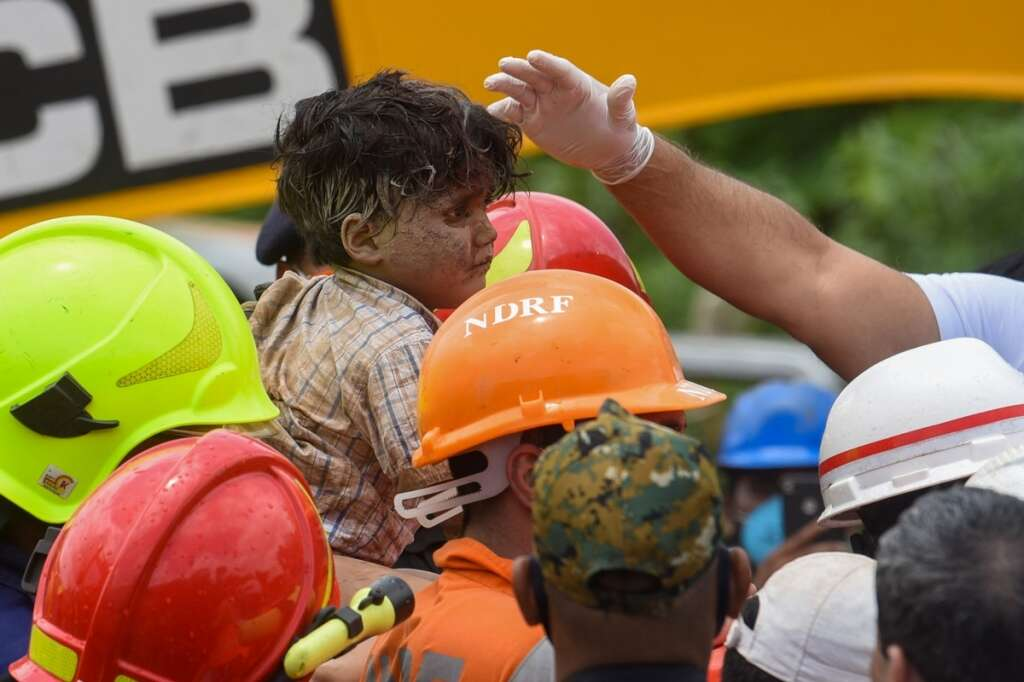 rescuers, four-year-old boy, rubble, collapsed, building, india, mahad