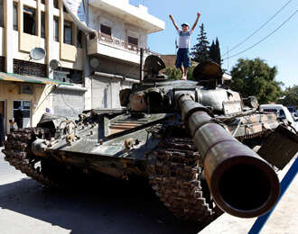 Syrian regime claims control of large Aleppo district