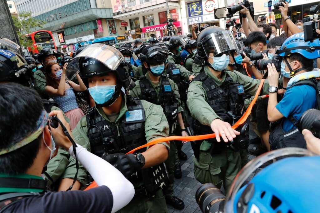 Hong Kong, police, 30, protests election Lam