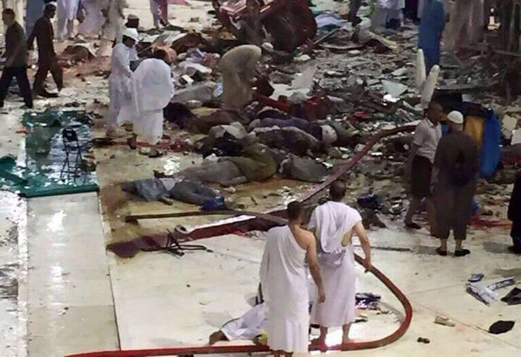 Pilgrims and first responders gather at the site of a crane collapse that killed dozens inside the Grand Mosque in the Holy City of Makkah, Saudi Arabia.