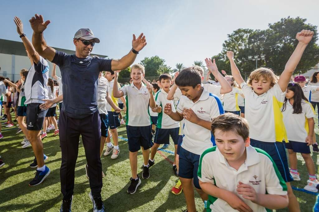 Dr Abdulla Al Karam, director-general of the KHDA along with students of Dubai British School participating in the The Daily Mile run.-Photo by Neeraj Murali