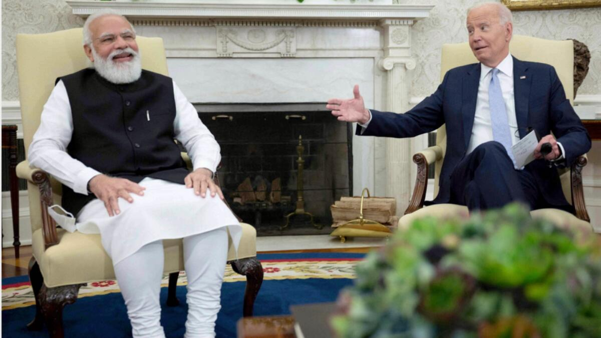 Joe Biden shares a light moment with Indian Prime Minister Narendra Modi  in the Oval Office of the White House. — AFP