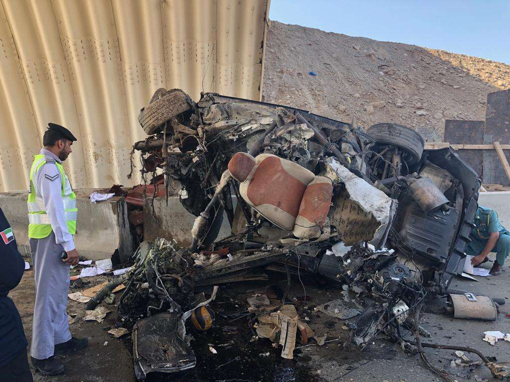 Photos: Man dies after smashing car into road barrier in UAE