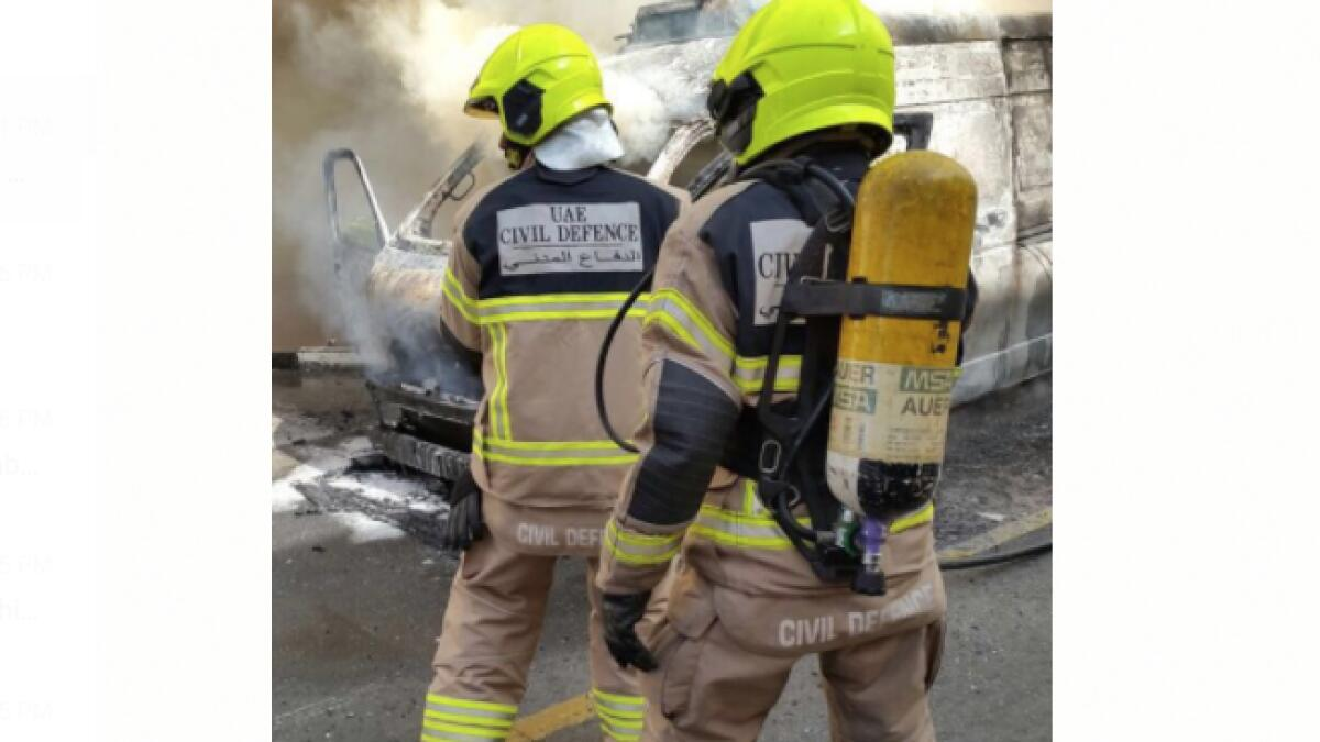 Firefighters from the Dubai Civil Defence work on putting out the fire