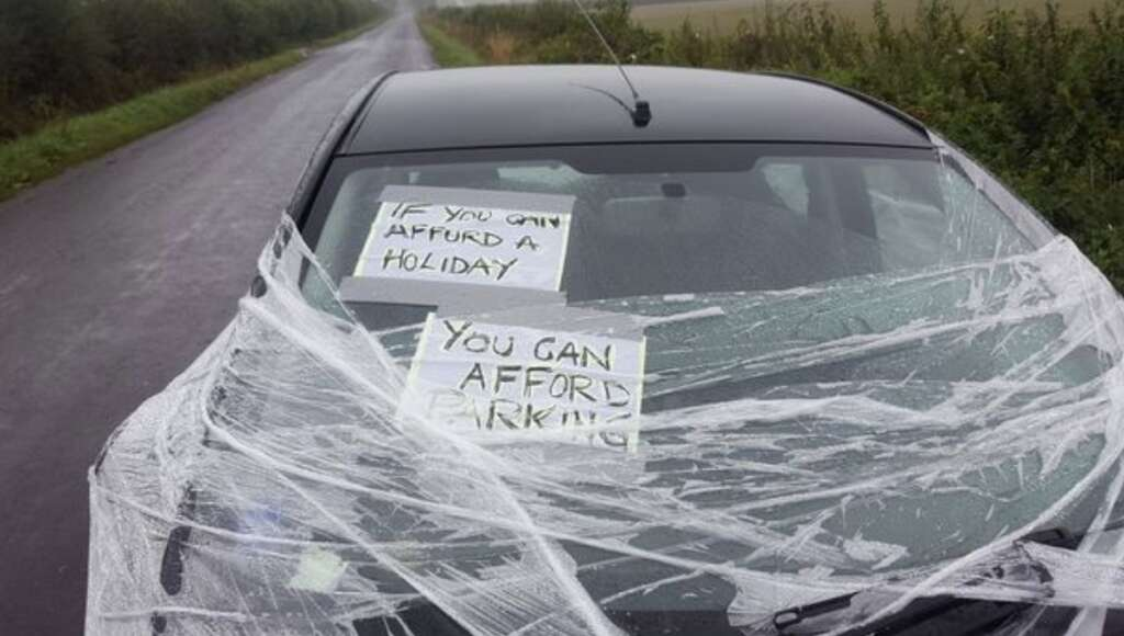 Illegally parked car wrapped in clingfilm, lashed with eggs
