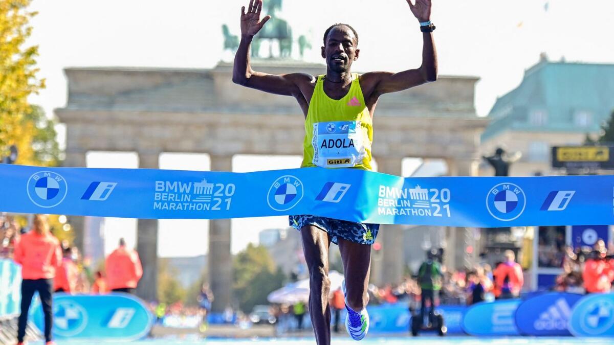 Ethiopia's Guye Adola crosses the finish line to win the Berlin Marathon on Sunday. — AFP