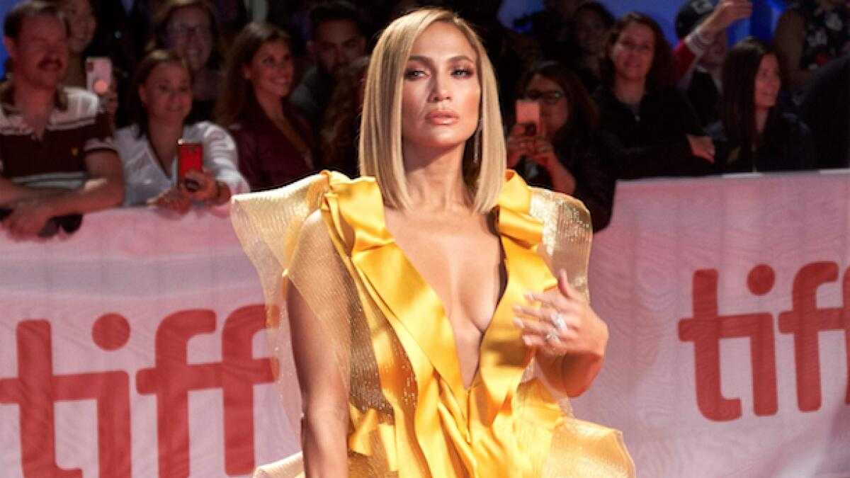 Jennifer Lopez at the movie premiere of Hustlers at TIFF in one of Yeya's creations