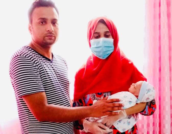 Stranded visitor, gives birth, UAE, family, faces, mounting bills, paperwork