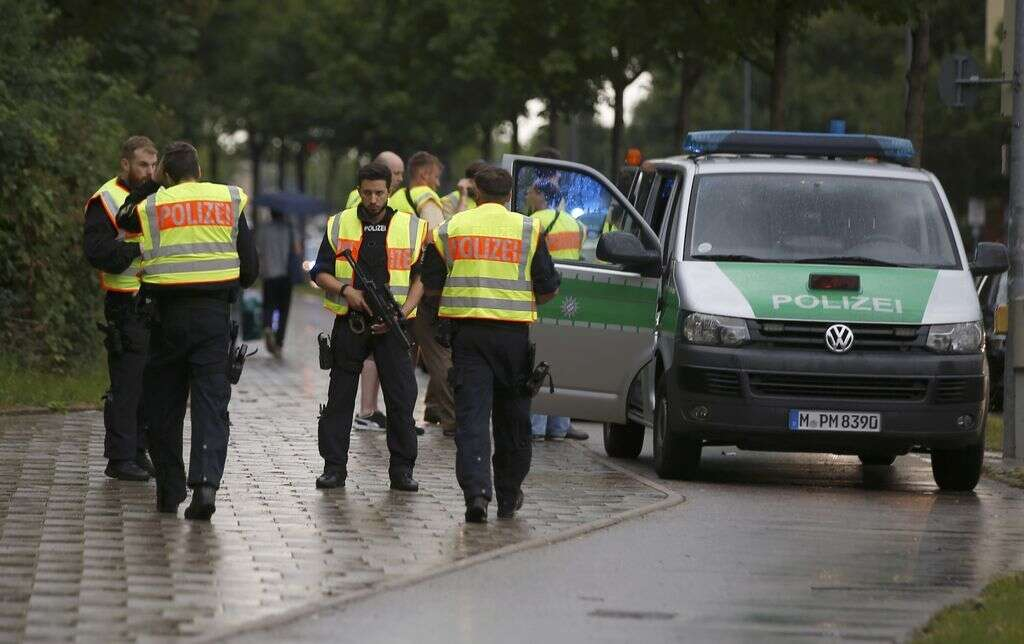 Police secure a street near to the scene of a shooting in Munich, Germany