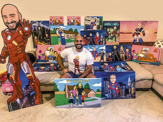 ENTREPRENEUR: Patrick Osman poses with a collection of his works