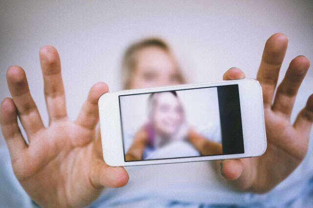 Woman held for sending enticing photos on social media