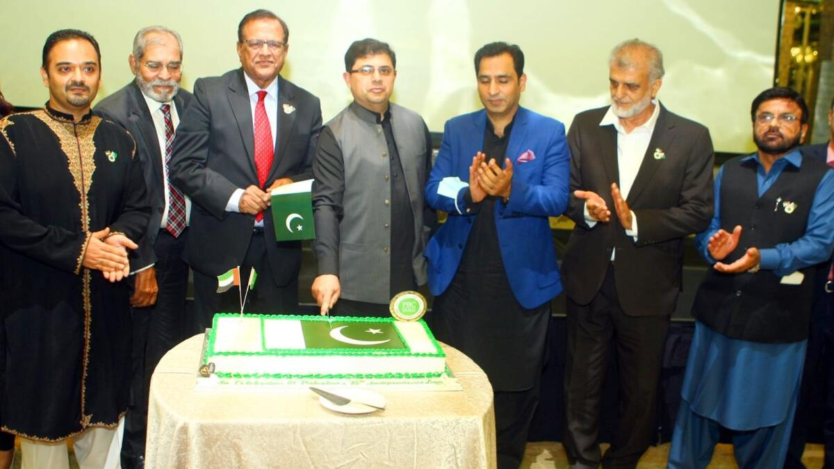 Hassan Afzal Khan, Iqbal Dawood, Shabbir Merchant and other guests at the cake-cutting ceremony to mark Pakistan's 75th Independence Day in Dubai late on Wednesday. -- Photo by Mohammed Mustafa Khan