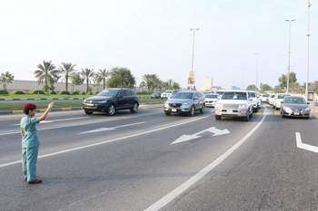 7-year-old Emirati boy mans traffic on UAE road