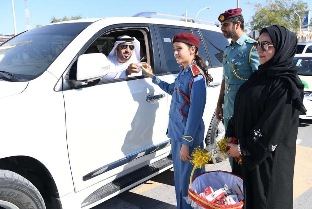 Grade 5, girl, student, cop, for a day, UAE, UAE flags, police patrol,