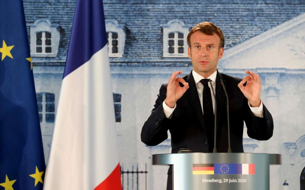 Emmanuel Macron, accuses, Turkey, criminal responsibility, Libyan, conflict