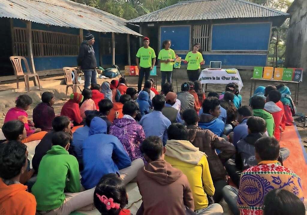 Green Hope members hold a community workshop in a rural village as part of their volunteer work.