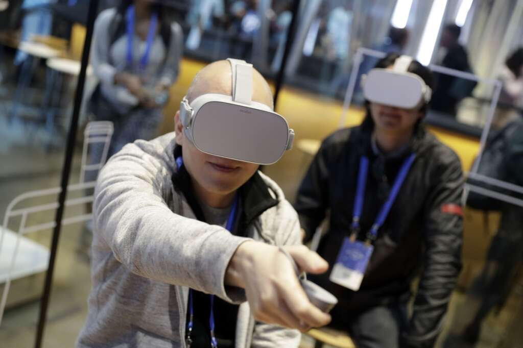 fab9d32e5282 Facebook unveils upgraded wireless Oculus headset in VR push ...