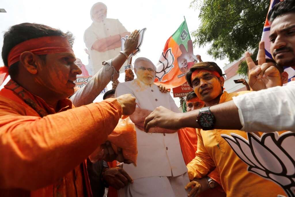BJP supporters celebrate after learning the initial election results.- Reuters