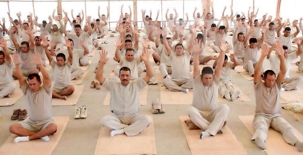 Inmates in Argentina do breathing exercises and meditation as part of the Prison SMART healing programme. —Supplied photo