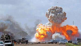 Gaddafi forces shell Libyan towns