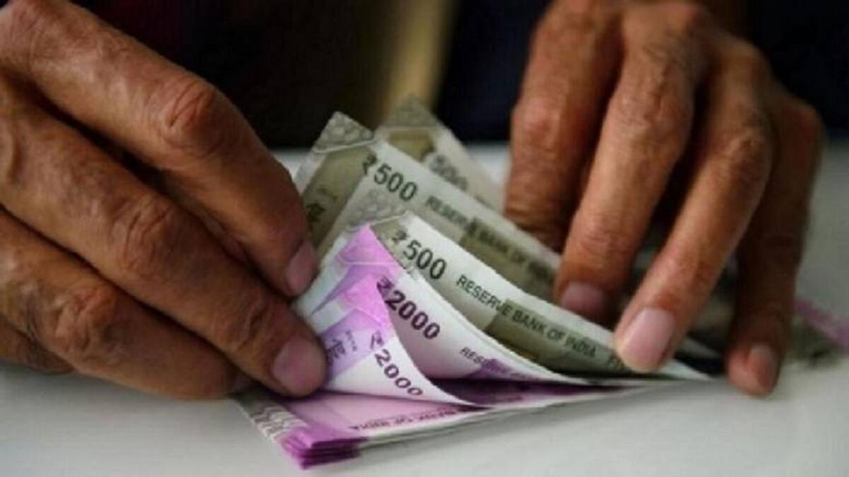 Indian rupee drops below 75 against US dollar