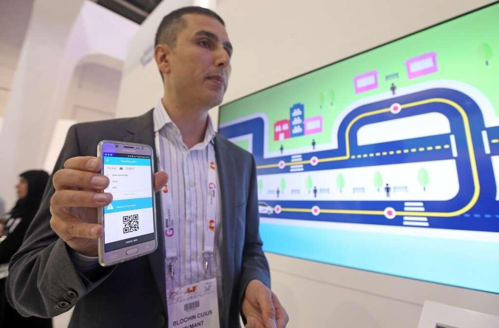 Blochin Cuius, CEO, MVMANT UG explains the Bus on Demand App at the RTA Pavilion