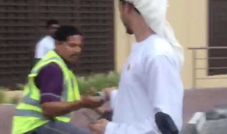 Police probe men caught giving away cash to strangers in Dubai