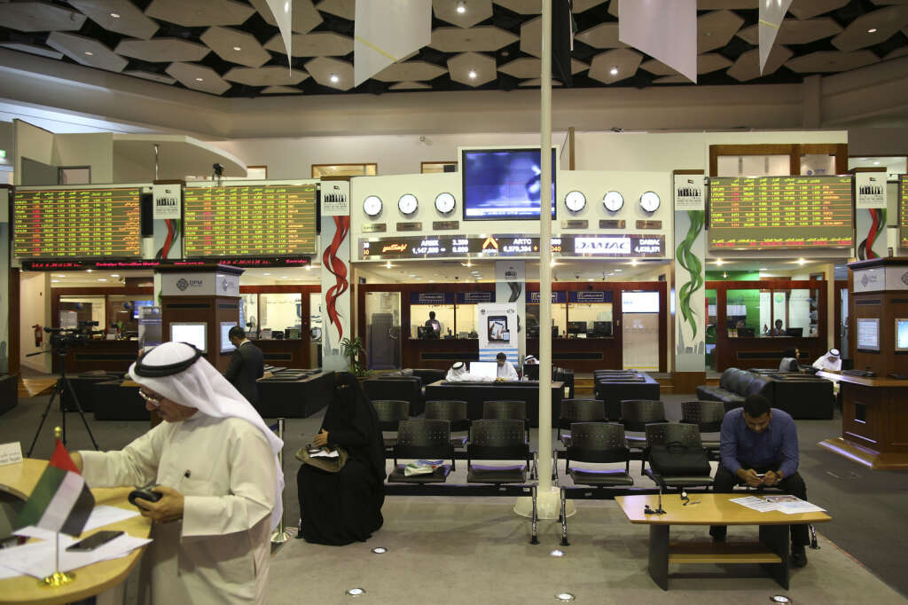 Traders work inside the Dubai Financial Market. Blue-chip stocks were the main drag on the bourse on Tuesday.