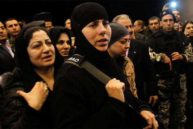 Nuns held by rebels in Syria are freed, arrive at border